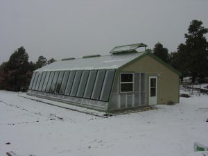 Passive solar greenhouse by Penn and Cord parmenter