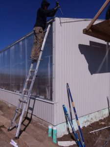 worker installing greenhouse
